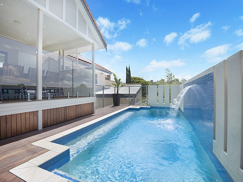 Concrete pool build with deck in Brisbane