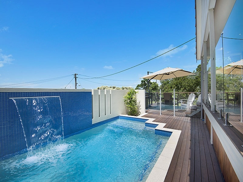 Concrete pool with alfresco dining area