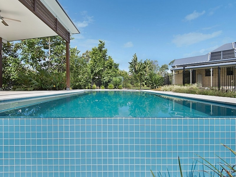 In ground pool with blue tiles