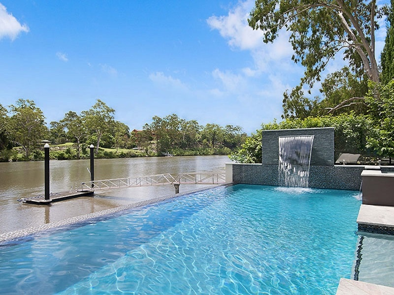 Infinity edge pool built for water front home by Cityscapes