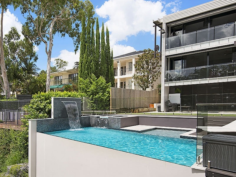 Infinity edge pool installation and house in Chelmer, Brisbane