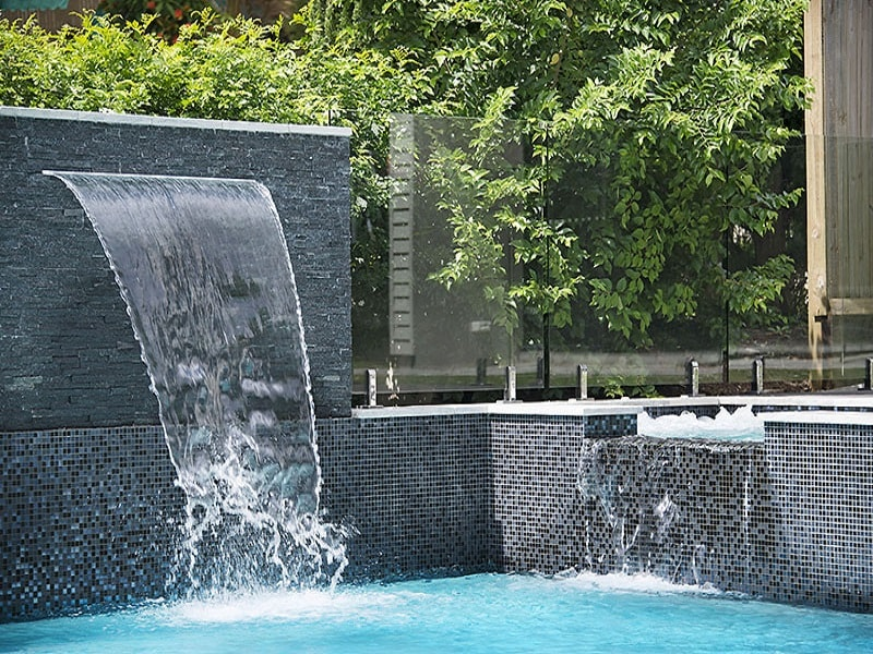 Infinity edge pool with water feature in Chelmer, Brisbane