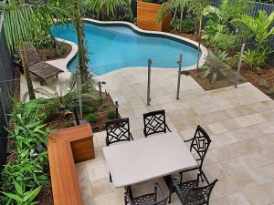 Pool with landscaping and dining area
