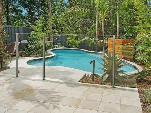 Tropical landscape next to pool by Cityscapes
