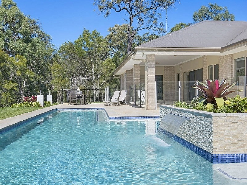 Lap pool with poolside dining area