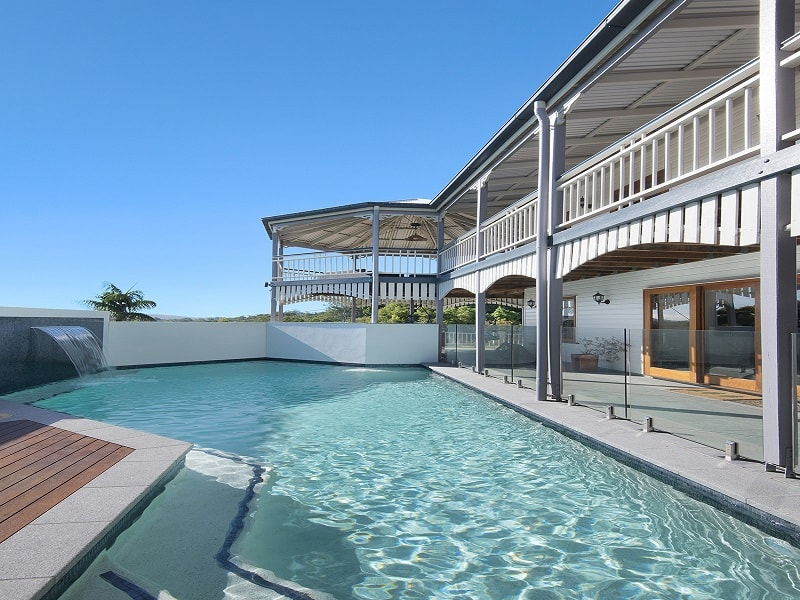 Swimming Pool next to Queenslander home