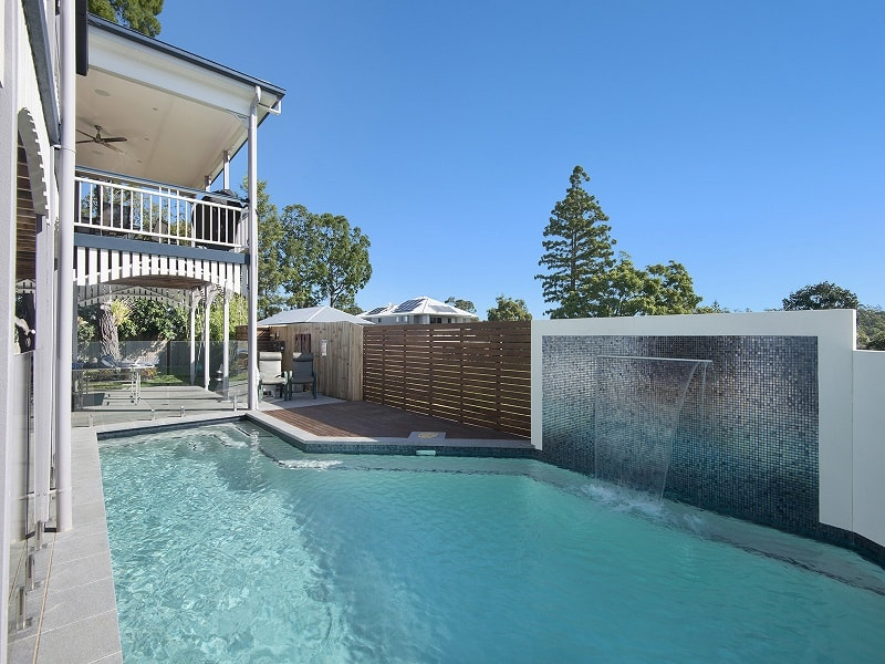 Swimming pool with a water feature in Brisbane