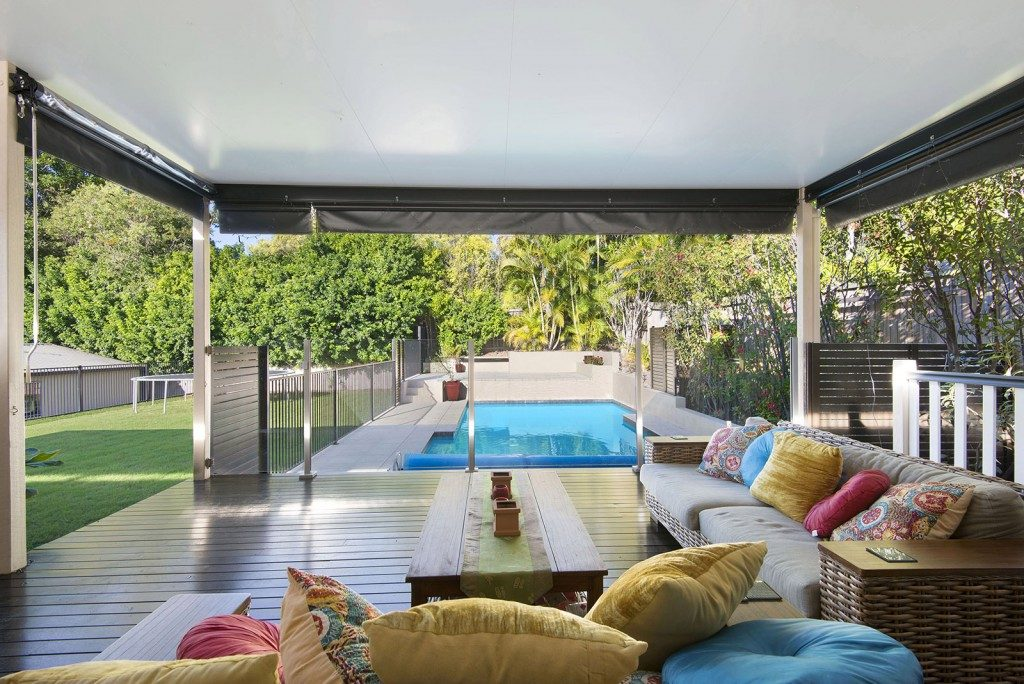 Outdoor lounge area with bright coloured pillows