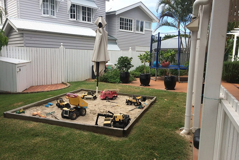 Outdoor kids area before landscape renovation