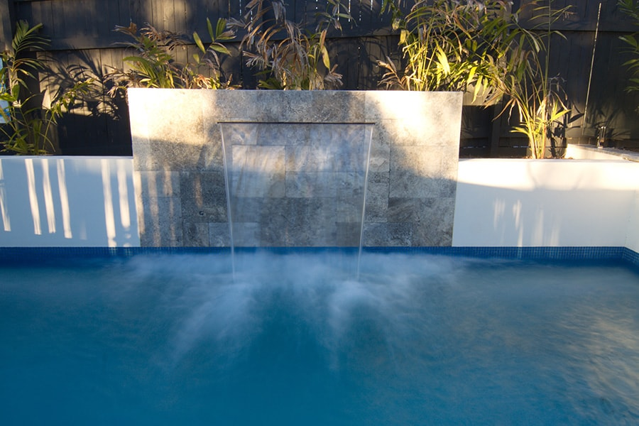Concrete pool with custom water feature designed by Cityscapes