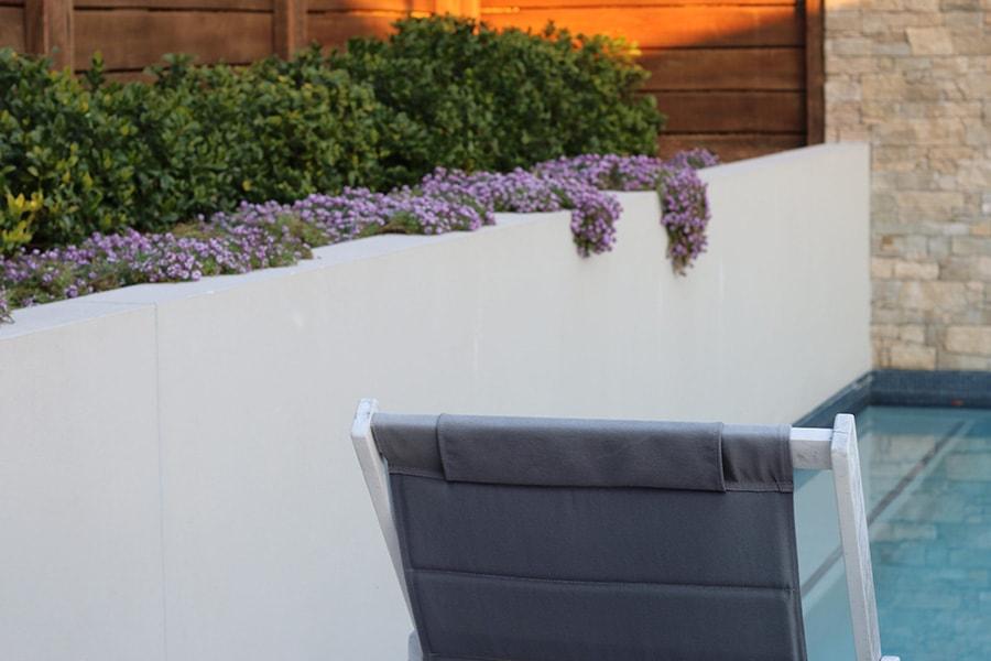 Custom concrete pool and purple flowers