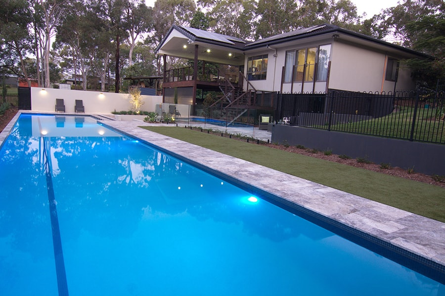 Lap pool with blue lights next to house in Burbank, Brisbane