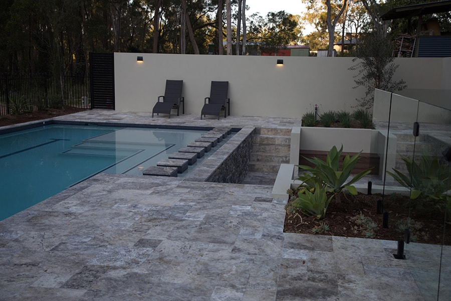 Lap pool with stone tiles in Burbank, Brisbane