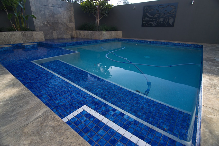 New pool build with blue tiles