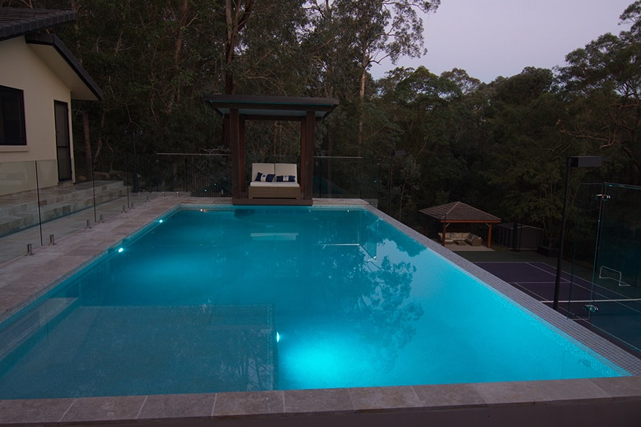 Out of ground concrete pool in the evening