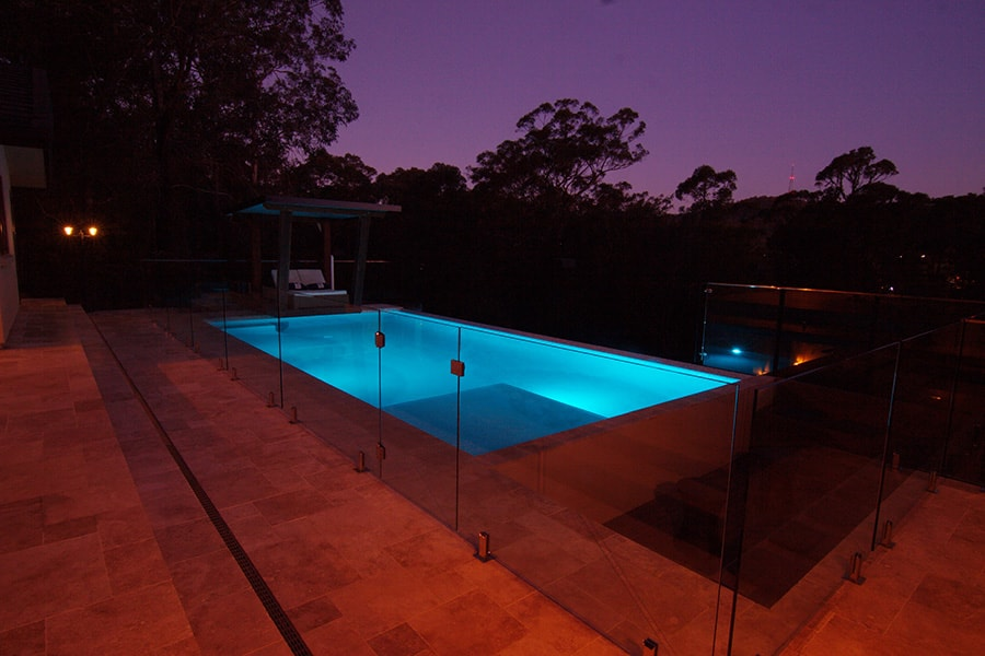 Above ground concrete pool at night