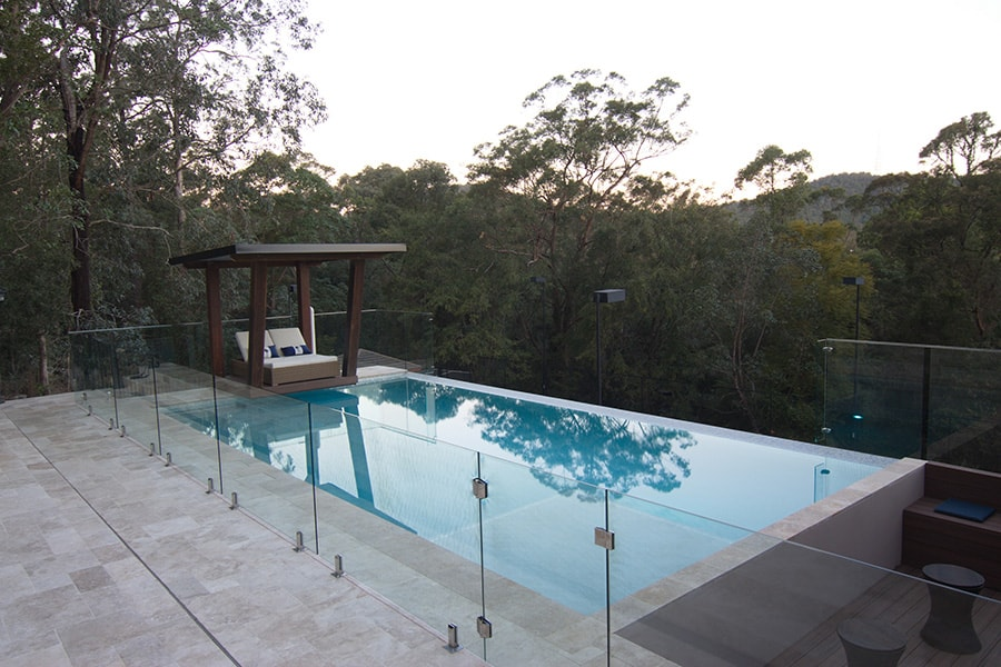 Above ground concrete pool with safety fence