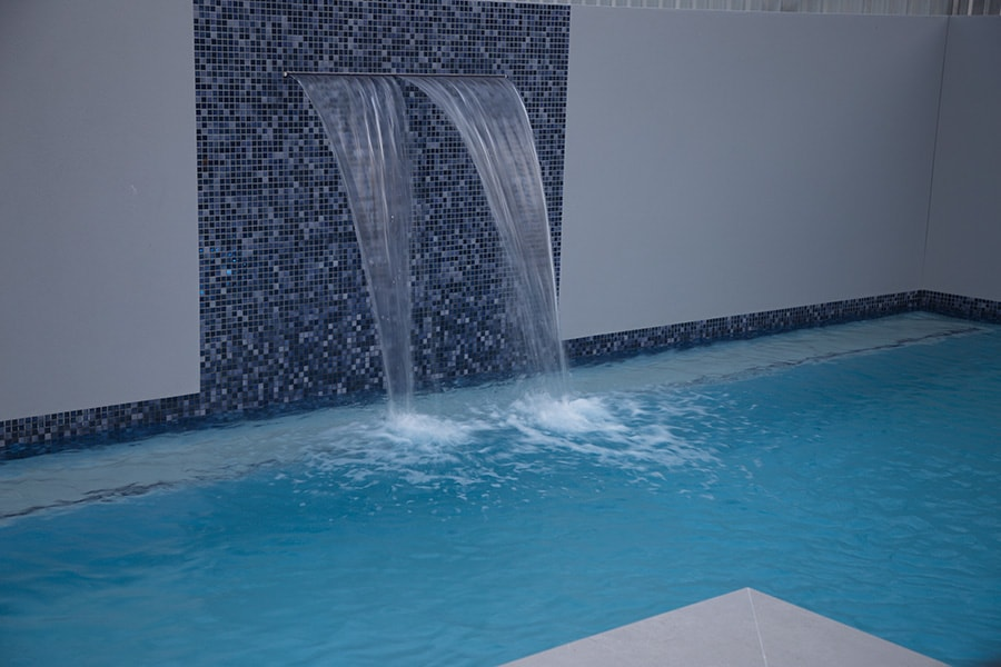 Plunge concrete pool with water feature
